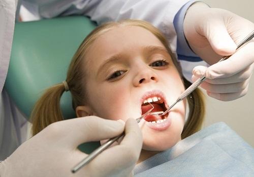răng sữa lung lay 2